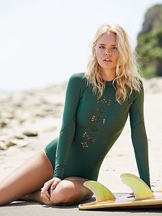 Lasercut Long Sleeve One Piece | Ride the waves and be a total beach babe in these neoprene wetsuit, laser-cut with a statement starburst down the bodice and at the cuffs. Easy half-zip on back. *By Amuse Society
