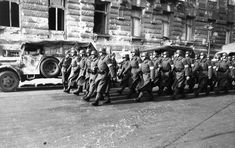 Different shot of the same Arrow Cross members marching in Budapest. Circa October 1944.