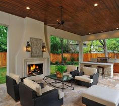 outside patio with fireplace, fan and built in bbq pit!