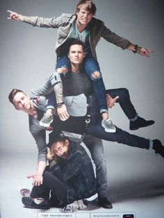 Harry Holding Danny With Dougie On His Shoulders And Tom Onto Leg Like