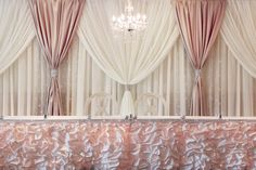 Head table of wedding- beautiful drapery and cute chandelier