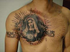 Graphic style virgin tattoo on the chest.