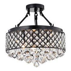 Your home deserves this stunning chandelier. This modern semi-flush mount fixture features a gorgeous round black metal frame that is embedded with octagon cut crystals that shimmer from every angle. Diamond cut tear drop crystals hang in a s Metal Shades, Black Metal Frame, Black Chandelier, Crystal Chandelier, Beaded Light Fixture, Sink Lights, Glam Lighting, Chandelier, Ceiling Lights