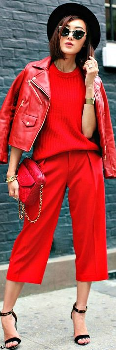 Shop this look on Lookastic:  http://lookastic.com/women/looks/hat-short-sleeve-sweater-biker-jacket-bracelet-crossbody-bag-capri-pants-heeled-sandals/8914  — Black Wool Hat  — Red Short Sleeve Sweater  — Red Leather Biker Jacket  — Gold Bracelet  — Red Quilted Leather Crossbody Bag  — Red Capri Pants  — Black Leopard Suede Heeled Sandals