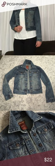 {Delias} perfect jean jacket The perfect denim jacket for pairing with pretty tops and dresses.   Size medium juniors, fits a 6 - 8.   19 inch length, 16 inches between shoulder seams.    Slightly distressed style, mild fading at elbows. delias Jackets & Coats Jean Jackets