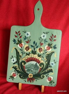 Norwegian Rosemaling -- Bread Board -- Hand Painted Light Green Background.--. $25.00, via Etsy.