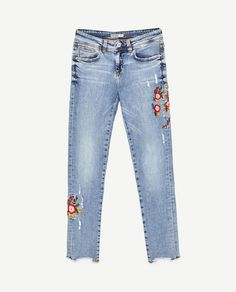 MID-RISE JEANS WITH EMBROIDERED FLOWERS