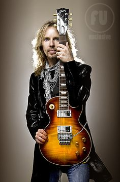 Tommy Shaw (and no he does NOT look like David Spade - David Spade looks like him). Guitarist and vocals for Styx. As original as you can get.