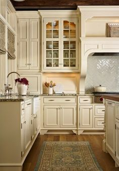 Creamy kitchen cabinets in this amazing kitchen. Yes, please.
