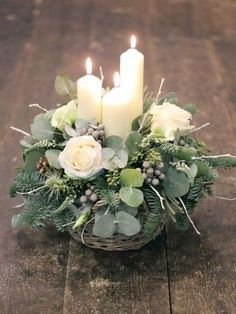 15 Christmas Table Centerpieces - Don't let your dining table empty without any decoration. The right Christmas table centerpieces will help you lighten up the mood of your guests. Christmas Flower Arrangements, Christmas Table Centerpieces, Christmas Flowers, Candle Centerpieces, Floral Arrangements, Candle Decorations, Candle Arrangements, Outdoor Decorations, Centerpiece Ideas
