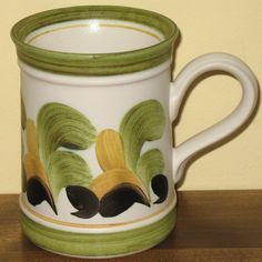 Denby stoneware, anyone? Denby has been making stoneware in England for more than 200 years crafting a high quality and durable product that we have come to know and love. These handsome Denby tankards or coffee mugs by Trish Seal feature strong hand painted brush strokes. Shown here in green and yellow, which is the last color option that I have available in my inventory. A happy customer was pleased to fill up his collection with the other color combinations that I had. Strong Hand, I Love Coffee, Antique Items, Paint Brushes, Brush Strokes, My Ebay, Decorative Items, Stoneware, Coffee Mugs