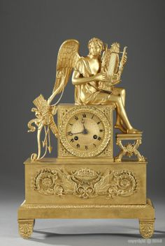Gilt bronze mantle clock with Apollo playing the lyre.