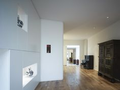 Organic wall contains several functions, like closets.  www.rocha.tombal.nl