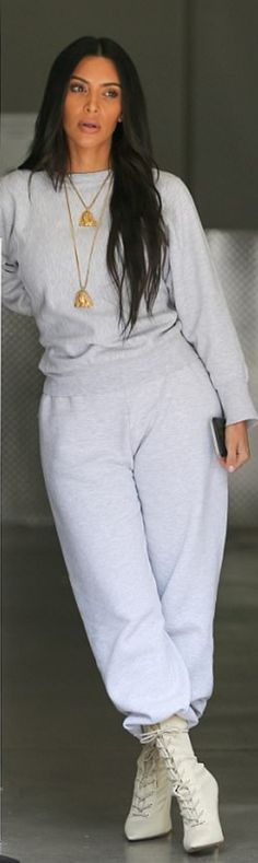 Who made  Kim Kardashian's gold jewelry, gray sweatpants, sweatshirt, and lace up tan boots?