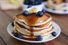Delicious Blueberry Pancakes that are perfect for Sunday morning! Homemade pancakes that are sweet, fluffy, and bursting with blueberries.