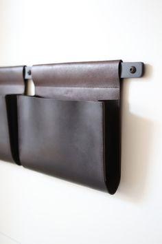 leather pockets by front door Henrybuilt Opencase leather bin| Remodelista