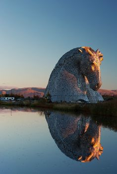 Kelpies, A Pair of Massive Stainless Steel Horse Head Sculptures in Scotland The Kelpies giant horse sculptures in Falkirk, Scotland.The Kelpies giant horse sculptures in Falkirk, Scotland. The Places Youll Go, Places To See, Beautiful World, Beautiful Places, Art Du Monde, Horse Sculpture, Water Sculpture, Scotland Travel, Scotland Uk