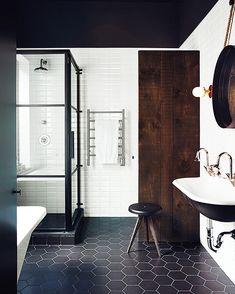 Instagram photo by @mydomaine • 3,781 likes - black bathroom tiles seem fresh and modern. Cool farm sink and black window pane shower.