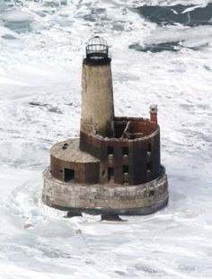 Built in 1851, this little lighthouse stands at the top of Lake Michigan on a reef where that Great Lake enters the Straits of Mackinac. It is a dangerous area for ships, full of rocky formations that can easily breach a ship's hull. It would seem to be the perfect spot for a lighthouse, but the light has been extinguished at Waugoshance since 1912.