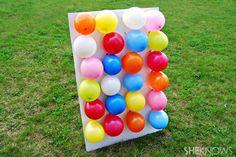Jeu de fléchettes avec des ballons. 16 activités amusantes à faire en plein air