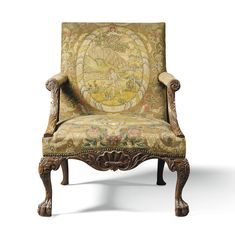 A George II walnut library armchair circa 1750 the close nailed upholstered back and seat covered in later needlework with oval pictorial vignettes within a floral background, with shaped arms carved with acanthus leaves, the apron shaped and carved with shells and leaves, on cabochon carved cabriole legs with acanthus leaves and hairy paw feet.