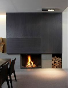 Clean fireplace + dark wood panneling.