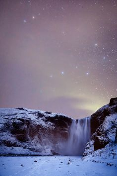 The night brings magic to the waterfall Skógafoss in Iceland. Come by during the winter and see the stars shine bright in the moonlight.