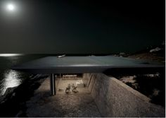 An infinity pool forms the roof of this Greek island retreat designed by Athens studio Kois Associated Architects. Situated on the south side of the island of Tinos