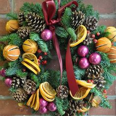 Front door Christmas wreath decorations dried fruits pinecones evergreens