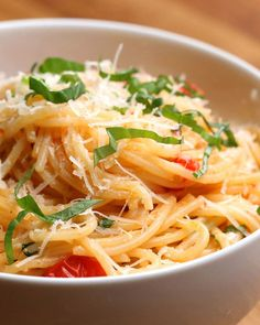 Servings: 4INGREDIENTS1 pound spaghetti2 tablespoons olive oil3 cloves garlic, minced2 cups chopped cherry tomatoesSalt, to taste Pepper, to taste1 cup white wine1 cup parmesan½ cup basil, choppedPREPARATION# Cook spaghetti in boiling salted water until it's al dente. Reserve 1 cup of the pasta water before draining.# While the spaghetti is cooking, heat olive oil in a large pan (it should be large enough to toss the pasta in). Add garlic and tomatoes, and stir until well-incorporated…