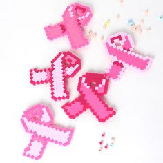 Make ribbons to wear and share to support the fight against breast cancer. Five designs in shades of pink beads.