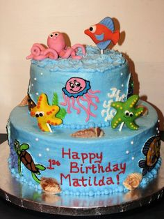 """2-tier cake (8"""" and 12"""") aquarium with FBCT fish and fondant octopus toppers, fondant starfish and one fondant fish made for a 1st birthday"""