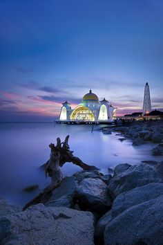 Malacca Straits Mosque - Malacca, Malaysia. This charming city is a UNESCO world heritage site, with a rich trading history and multicultural heritage. Melaka is a rewarding town to explore and is about two hours from Kuala Lumpur.