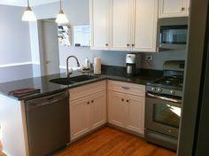 Slate Appliances, White Cabnets, Grey Walls