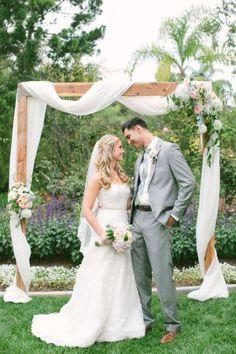 I like that simple wedding arch! #BackyardWeddingIdeas #BackyardWedding