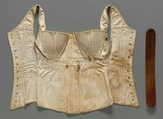 Stays with busk - cotton sateen with cotton twill lining, cording and quilting - c1830. museum for fine arts, Boston.
