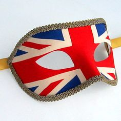 vintage Union Jack Masks for Masquerade Ball  Antiqued Union Jack fabric on an authentic Venetian Masquerade Mask base, trimmed with military old gold braiding…makes us think of VE Day..