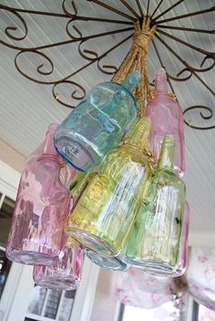 Inspiration -- Use small glass bottles for a wind chime. on the front porch, lovely pastel colored glass bottles turned into a hanging ceiling fixture Colored Glass Bottles, Bottles And Jars, Mason Jars, Painted Bottles, Soda Bottles, Glass Jars, Pastel Palette, Pastel Colors, Pastel Shades