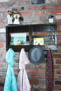 pallet coat rack with 4 hooks and storage.