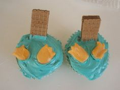 Perry the platypus cupcakes! Looks like chocolate wafer cookies for tails and some sort of candy rolled and cut for feet.