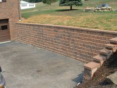 Pittsburgh retaining walls installation by PGHSW uses retaining wall block like Omni Stone and Versa-lok for it's retaining wall construction. Retaining Wall Construction, Privacy Walls, Wall Installation, Pittsburgh Pa, Landscape Design, Outdoor Living, Sidewalk, Patio, Free