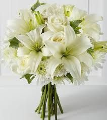 I love white asiatic lilies...especially in bridal bouquets. Steps up the look without going way over budget.