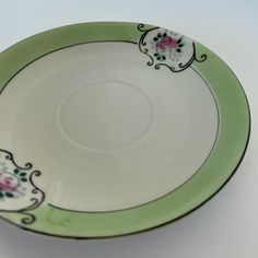 🐣. Offer Xtras! Chikaramachi Saucer green and white Japan saucer, vintage saucer for $21.00 #1930sSaucer #ArtDecoSaucer #TeacupAndSaucer #VintageSaucer #MadeInJapan #AntiquePlate #CollectiblePlate #ChikaramachiSaucer #VintagePlate #TeacupSaucer Etsy Vintage, Vintage Shops, Vintage Items, Antique Plates, Vintage Plates, Star Wars Light Saber, Tea Cup Saucer, Home Decor Items, Bone China
