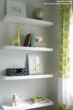Floating shelves with nursery goodies designed by Amelia from House Pretty Blog