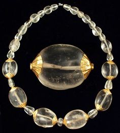 Roman Rock Crystal and Gold Necklace, c. 1st-2nd Century AD Composed of fourteen scaraboid shaped rock crystal beads, form-fit with gold collars soldered to small cylindrical gold sheet terminations; fourteen conical rock crystal beads; one compressed sphere bead.