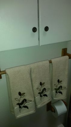 New paint on bathroom cabinet and new hand towels