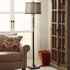 Mirrored glass column on a bronze-burnished base. Hand-finished shade in a gleaming antiqued silver hue. Sleek metal fittings, tip to toe. Gabrielle puts Deco in a dazzling new light. Put on your shades and flip the switch.