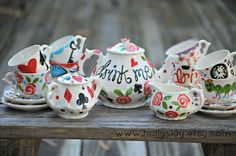 The hearts, clocks, keys, cheshire cat, mushrooms, playing cards, roses! All the elements of Alices whimsical movie!    Handpainted porcelain tea set,