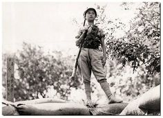 A Chinese child soldier during World War II. c. 1942