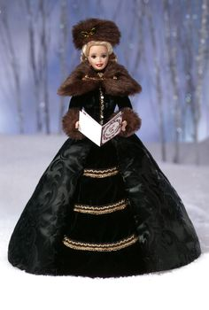 Sing along with this porcelain Barbie as she hits every holiday high note. Holiday Caroler™ Barbie® Doll.